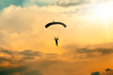 unidentified skydiver, parachutist on sky