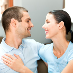 Young happy smiling attractive couple at home