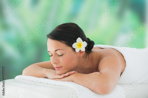 canvas print picture Beautiful brunette relaxing on massage table