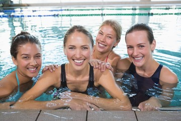 Female fitness class smiling at camera