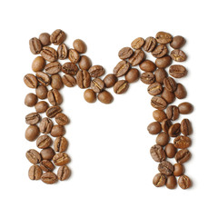 Letter M arranged from coffee beans isolated