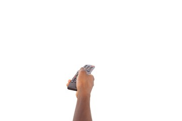 Mans hand holding remote control