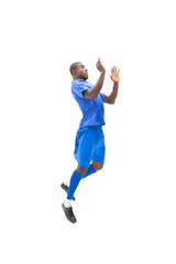 Football player in blue jumping on white background