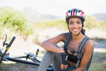 Fit woman taking a break on her bike ride