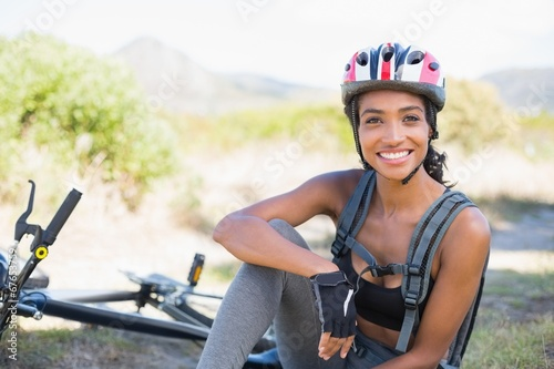 canvas print picture Fit woman taking a break on her bike ride
