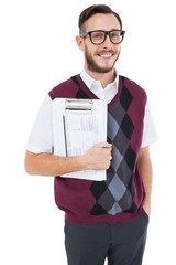 Geeky man holding clipboard in vest