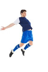 Football player in blue jersey jumping
