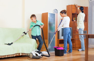 Family of three doing cleaning
