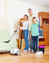 family of three with  cleaning equipment