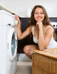Housewife using washing machine