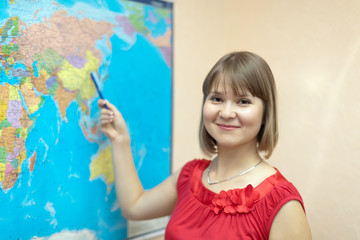 Woman shows something on  worldmap
