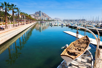 Port with yachts and and embankment. Alicante