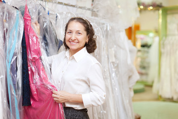 mature woman  chooses dinner gown