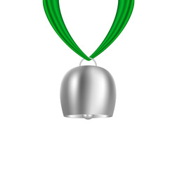 Cowbell hanging on green piece of cloth