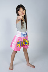 Portrait of Little asian cute Girl in thai boxing uniform