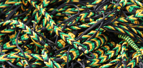 A Collection of Jamaican Coloured String Bracelets.