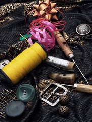 thread,button,crochet hook, and other sewing tools