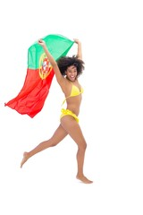 Fit girl in yellow bikini holding portugal flag laughing at came