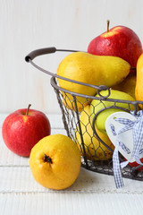 ripe pears and apples in basket