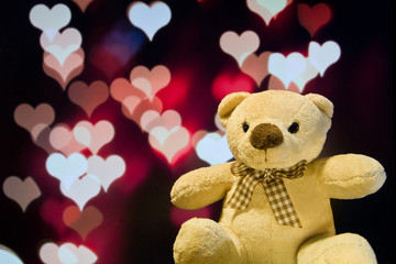 Lovely teddy bear with love bokeh