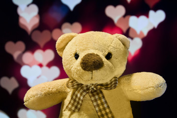Lovely teddy bear with love bokeh background