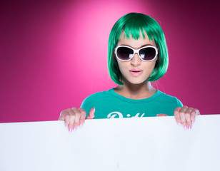 Young woman with a colorful green hairstyle