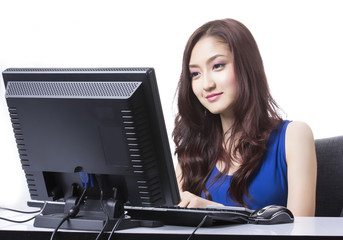 Asian girl use PC computre for search and do something