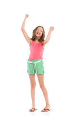 Laughing girl with arms raised