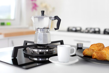 Italian coffee maker and croissants