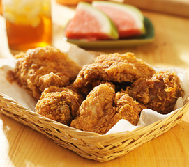 basket of fried chicken with sweet tea and watermelon