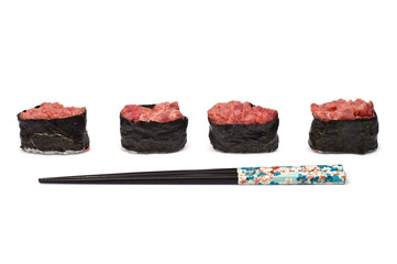 Four Gunkan Maki with Tuna and Chopsticks isolated on white