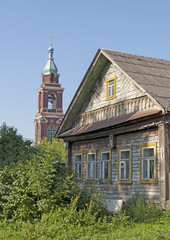 Old wooden house and bell tower