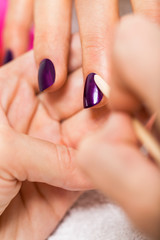manicure making in beauty spa salon