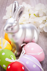 Easter still life with a silver bunny and eggs