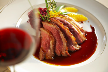 close up duck grilled steak and sauce in white dish