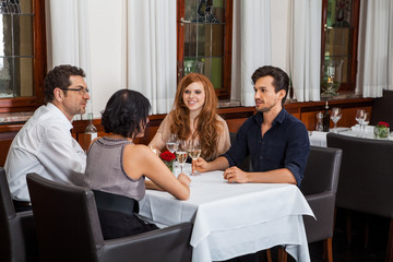 Waiter happily accommodating couple