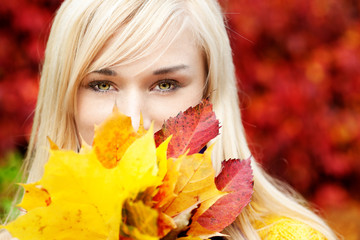 Beautiful Young blond woman with leafs