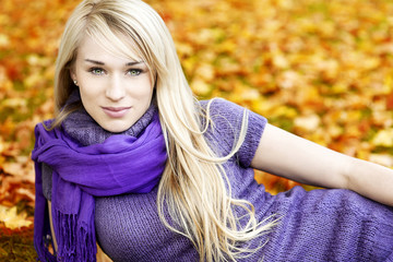 Beautiful Young blond woman with leafs - autumn portrait