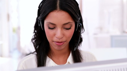 Call centre agent working and talking on headset