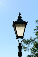 Old style lamppost with cobwebs