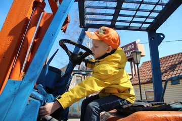 boy playing at loader