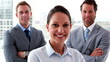 Confident business team smiling at camera