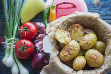 baked potatoes with garlic and fresh vegetables