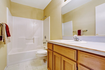 Empty bathroom interior in soft ivory