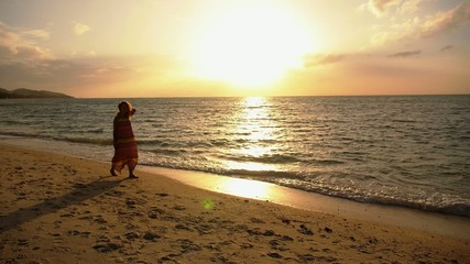 Young Serene Woman Walking Alone on Sunset Beach. Slow Motion.