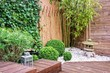Japanese garden with bamboos and stone lantern - 67675184