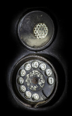 Old black telephone. Close-up of a rotary dial