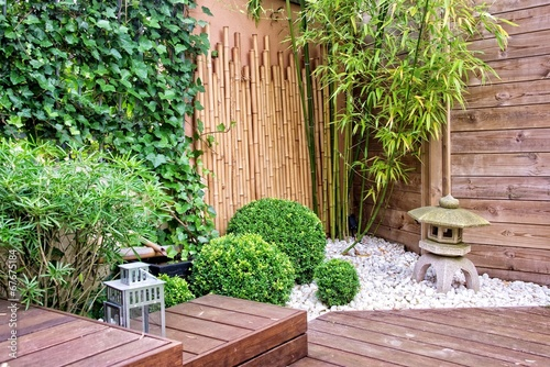 Foto op Canvas Tuin Japanese garden with bamboos and stone lantern