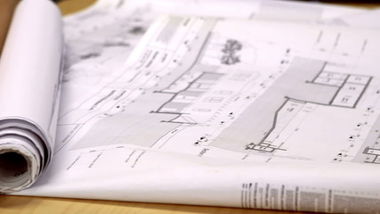 Blueprints on architects desk