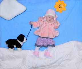 girl with a toy dog walks winter